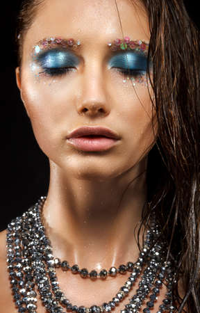 Alluring Wet Woman Face - Beads Necklace, Bright Blue Makeup Stock Photo - 17255251