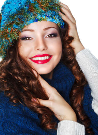 Happy Smiling Brunette wearing Knitted Blue Cap and Jersey Stock Photo - 17221801