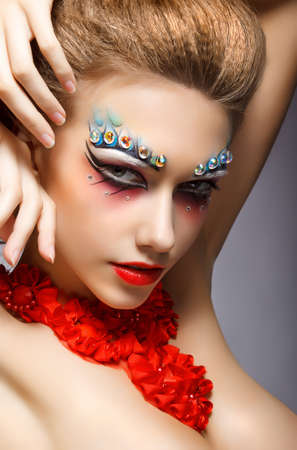 strass: Perfect Fashion Woman Face with Strass - Bright Eye Makeup. Theater