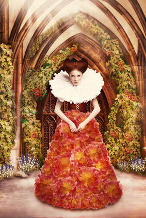 biblical: Red Hair Duchess in red Dress and Jabot in Ancient Abbey Stock Photo