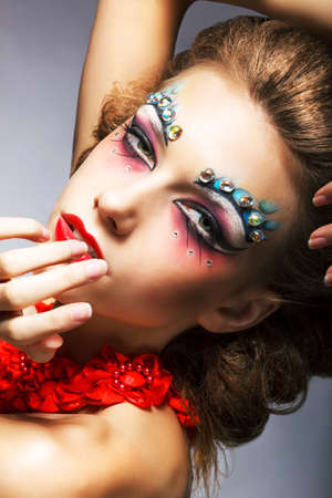 Creativity. Shiny Woman Actress with Bright Make Up. Glamor photo