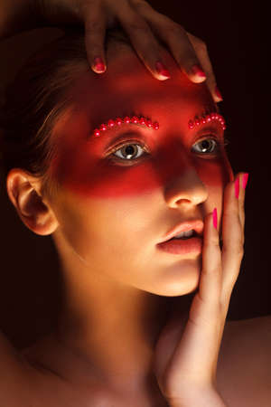 Fashion Art Concept. Beauty Woman Face with Red Painted Mask Stock Photo - 17573732