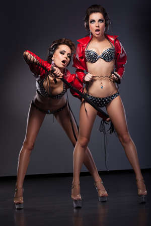 Fetish. Funny Sexy Women in Erotic Pose with Whip. Excitement Stock Photo - 17664476