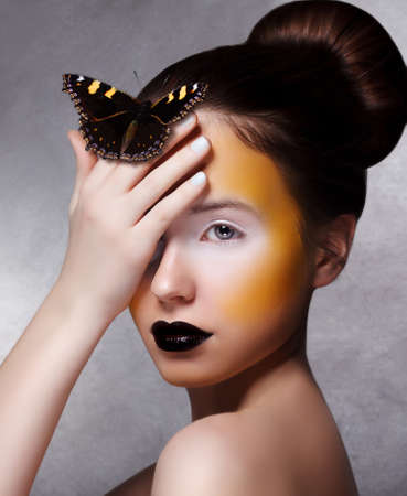 drama: Trendy Woman with Butterfly. Creative Bright Make Up. Black Lips