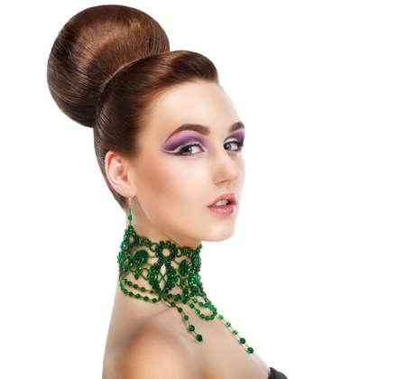 Profile of Stylish Woman with Green Gems. Luxury. Aristocratic Profile Stock Photo
