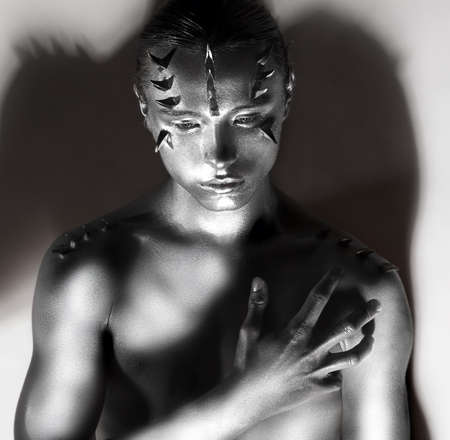 silver plated: Mans Silver Plated Body in Shadows. Thorns Silhouette. Creative Art Design Stock Photo