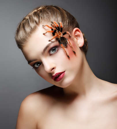 braided hair: Fantasy. Portrait of beautiful Female Tamer with Spider Stock Photo