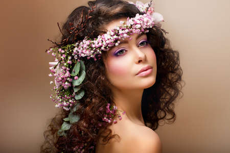 Nymph. Adorable Sensual Brunette with Garland of Flowers looks like Angel photo