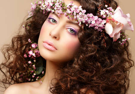 Maiden. Beautiful Neat Woman with Pink Romantic Wreath. Classy Brunette photo
