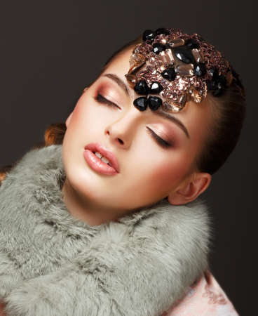 Passion. Glamorous Dreamy Woman in Fur Mantle and Jewels. Luxury photo