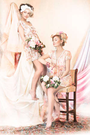 Sophistication. Old-Fashioned Concept. Two Pin Up Girls in Retro Dresses. Luxury photo