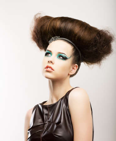 Fetish. Artistic Expressive Brunette with Frizzy Hairstyle. Creative Styling photo