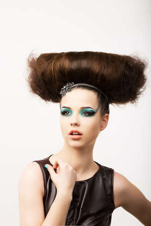 extraordinary: Glamour. Vitality. Portrait of Unusual Brunette with Extraordinary Festive Hairdo