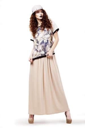 kepi: Modish Glamorous Woman in Fashion dress and Cap posing  Studio shot Stock Photo