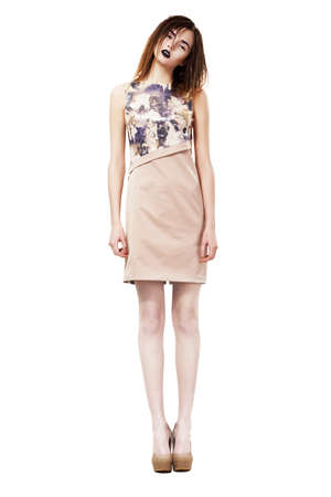 sophistication: Beautiful Fashion Model standing on Podium. Series of photos