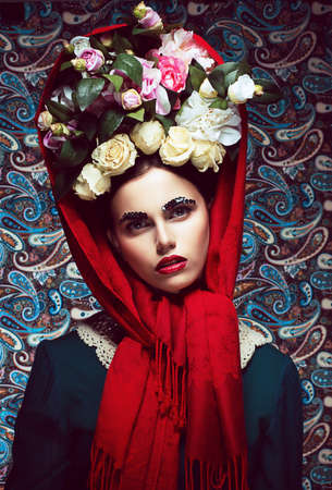 Vintage. Woman in Red Shawl and wreath of Roses. Retro photo