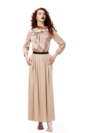 frizzy: Romantic Elegant Barefoot Frizzy Woman in Brown Tunic posing Stock Photo