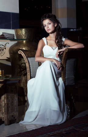 Wedding Style. Aristocratic Bride sitting in White Dress. Restaurant Interior Stock Photo - 18462471