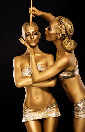 fantasy makeup: Fantasy. Creativity. Shiny Womens Gold Gilded Bodies. Arts