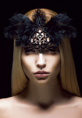 Beautiful Genuine Woman in Styled Black Mask with Feathers. Aristocratic Face Stock Photo - 18462513