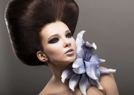 Extravagance. Classy Woman with Lily. Stylish Hairdo. Luxury Stock Photo - 18410819