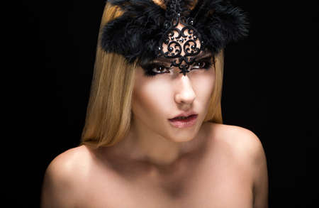 allure: Allure. Fascinating Fancy Woman in Black Carnival Mask with Feathers.  Stock Photo