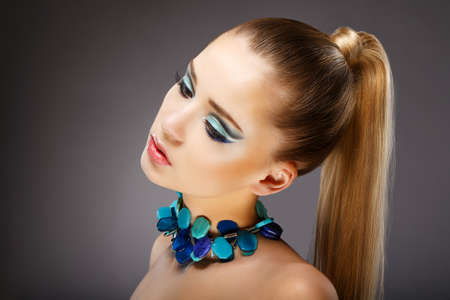 Allure. Profile of Sensual Woman with glazed Green - Blue Jewels. Relax Stock Photo - 18499291