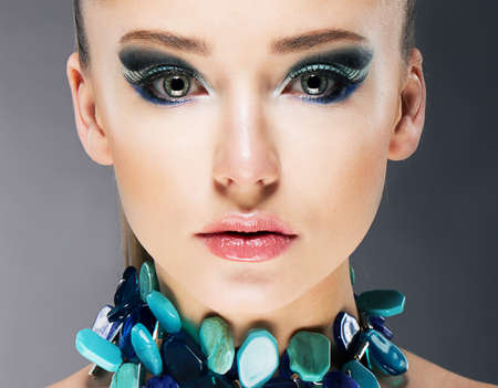 eyeliner: Glamorous Confident Woman in Semi Precious Turquoise Necklace close up Stock Photo