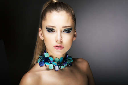 Luxury. Gorgeous Trendy Woman with Turquoise Necklace Stock Photo - 18499190