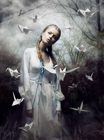 dreamy: Mystery. Origami. Woman with White Paper Pigeon. Fairy Tale. Fantasy