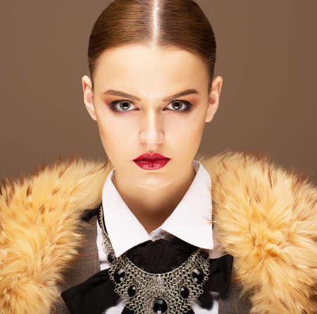 Elegance. Sophisticated Haughty Woman in Fur Collar. Lifestyle photo