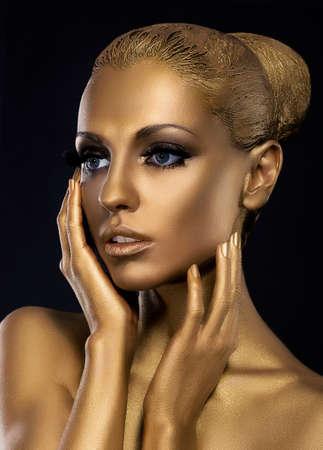 Gilt. Profile of Surprised Golden Womans Face. Fantasy