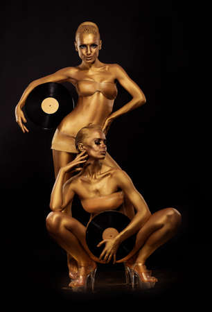 Gold Bodyart  Coloring  Golden Women Silhouettes with Retro Vinyl Records over black  Creative Art Concept photo