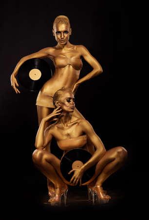 Gold Bodyart  Coloring  Golden Women Silhouettes with Retro Vinyl Records over black  Creative Art Concept