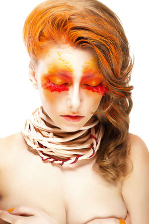 close up eyes: Fiery Stylized Woman with Closed Eyes. Red False Lashes. Creative Make up