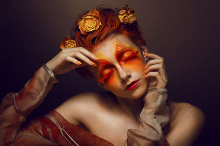 Bodyart  Imagination  Artistic Woman with Red - Gold Makeup and Flowers  Coloring photo