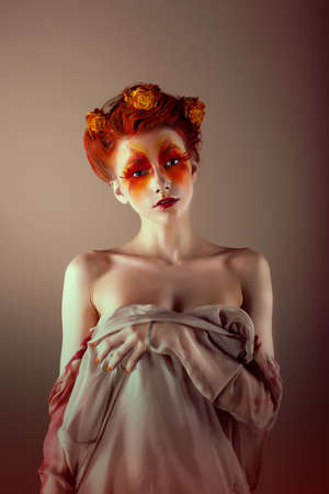 Portrait of Unusual Redhead Woman with False Red Eyelashes  Fantasy photo