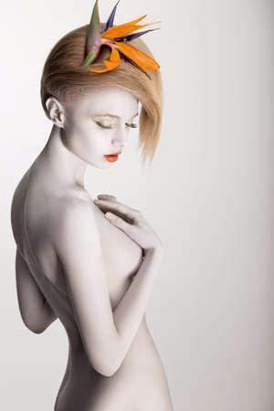 White Bodyart. Stylish Futuristic Woman with Headwear - Yellow Flower. Paint Skin