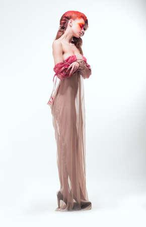 transparent dress: Imagination. Expressive Woman in Transparent Dress. Dreams Stock Photo