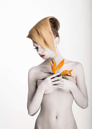 White Body Art. Daydreaming Naked Woman holding Fresh Flower. Exotic Hairstyle Stock Photo - 18527280