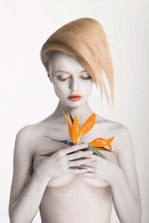 Bodypainting. Enigmatic Gorgeous Woman with Strelitzia flower in hands. Painted Skin Stock Photo - 18527281