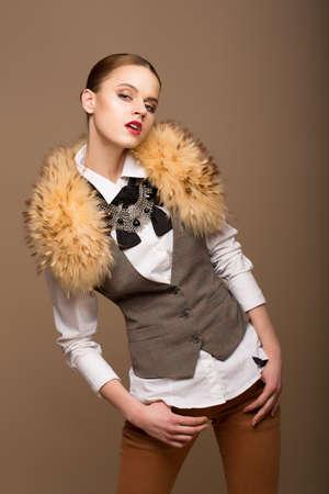 Portrait of Perfect Arrogant Woman in Grey Waistcoat and Fur Collar photo
