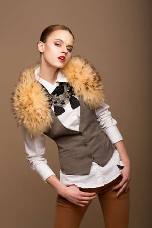 urbanized: Portrait of Perfect Arrogant Woman in Grey Waistcoat and Fur Collar Stock Photo