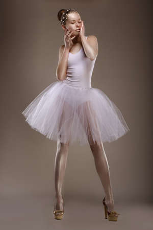 pearly: Charming Woman in White Tutu with Pearly Beads over Grey  Ballet Stock Photo