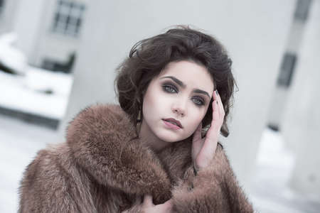 Femininity  Portrait of Sophisticated Young Brunette in Brown Fur Coat Outdoors Stock Photo - 18553184