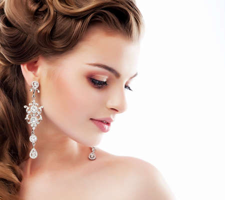 earring: Pure Beauty. Aristocratic Profile of smiling Lady with Glossy Diamond Earrings. Femininity & Sophistication Stock Photo