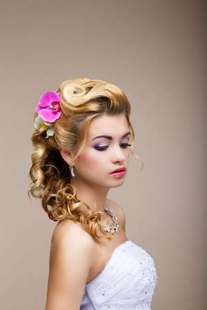 Dreams. Desire. Thoughtful Luxurious Bride Blonde - Gorgeous Hair Style. Purity photo