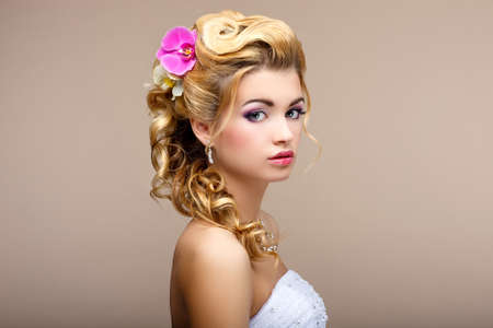 Charm. Portrait of Elegant Blond hair Woman Fiancee with Flowers. Womanliness photo