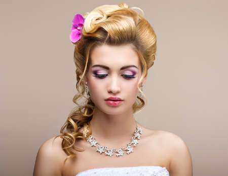 Wedding. Beautiful Thinking Bride with Diamond Necklace. Elegance & Femininity photo