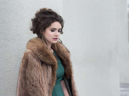 Elegance. Charming Autumn Brunette in Fur Coat in her Thoughts photo